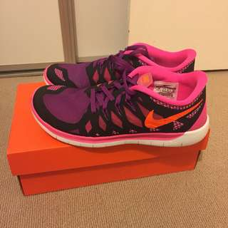 Brand new Nike pink running shoes