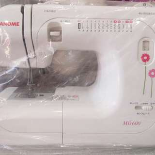Sewing machine electric