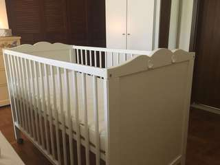 IKEA baby cot with mattresses and wheels