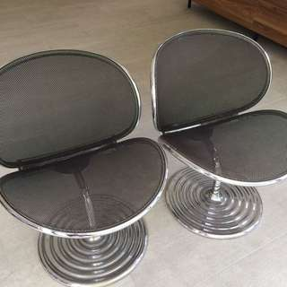 A pair of Mesh designer chair stainless steel frame