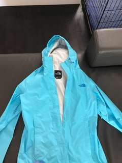 The north face aqua colour rain coat