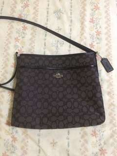 Authentic coach sling bag in black