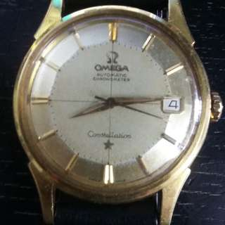 18K omega piepan from sotheby