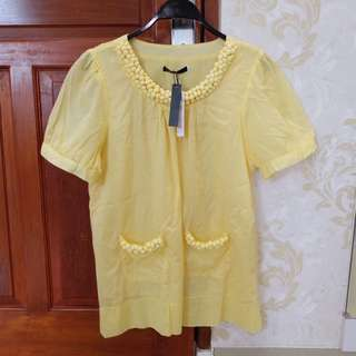 Yellow ball top