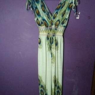 Long dress motif bulu merak