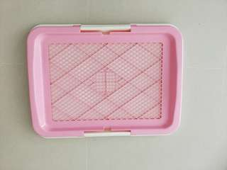 New unused pink pee tray