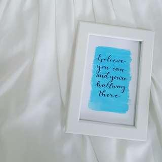 Handwritten quote in frame