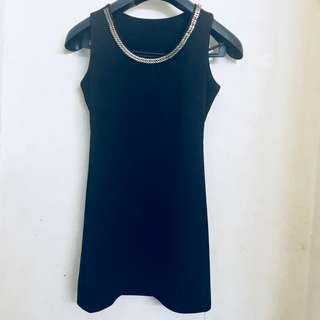 Black dress with accessory