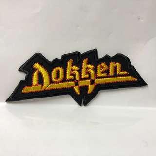 Dokken - Yellow Logo Shaped Woven Patch