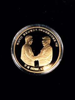 2001 North Korea 1 Won 2000 13th-15th June Meeting in Pyeong-Yang North & South Korea Joint Declaration, Leaders Kim Dae-jung & Kim Jong-il. Juche 89th Year Political Theme, Large Golden-Gilt Brass Coin. Mint Uncirculated Condition, Ultra Rare.