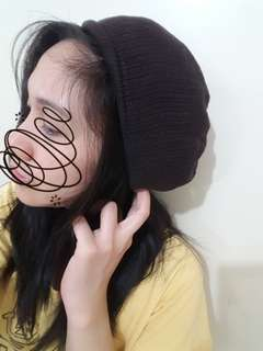 Dark brown knitted beanie