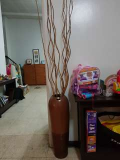 Brown vase with bamboo