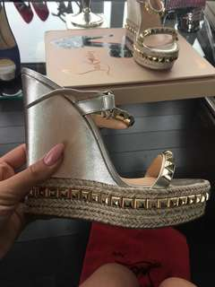 Stunning like new gold Louboutin platforms