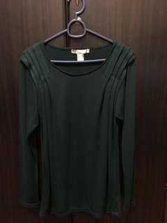 Green long-sleeved blouse