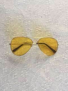 Yellow coloured sunglasses with gold frame