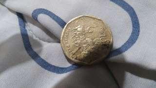 Uang logam 100 rupiah karapan sapi