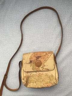 Mela around the world sling bag