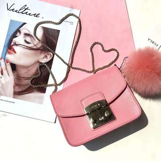 Furla Metropolis latest pastel fur ball collection - peach pink
