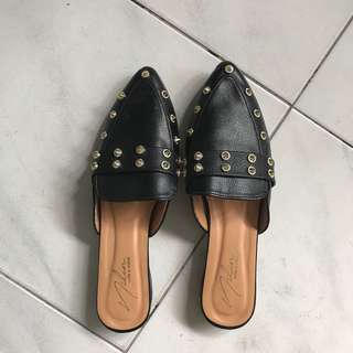 Studded black slip-ons