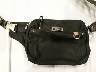 Tumi man's sling bag.