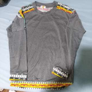 Gray sweater with Aztec stripes sleeves