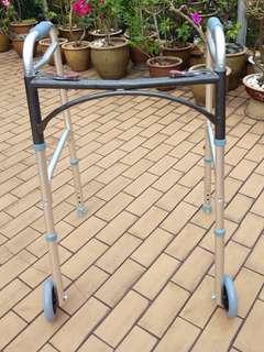 elderly walker with wheels