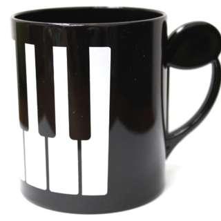 2 Music Keyboard Plastic Mugs at $20
