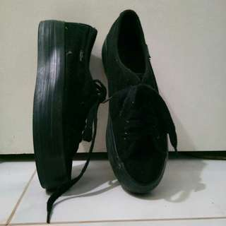 Black chunk rubber shoes