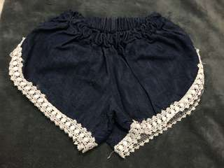 Denim shorts with bottom lace