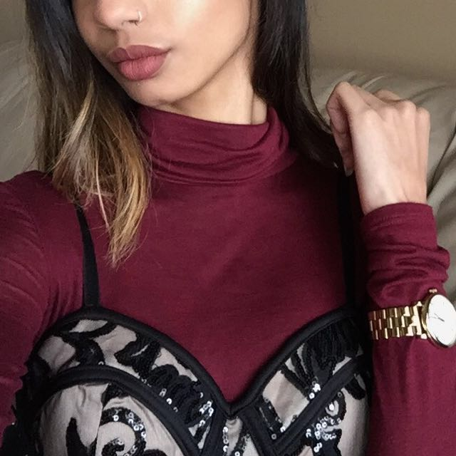 Sheer maroon turtleneck bodysuit from M Boutique