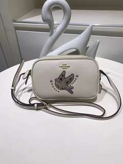 Coach crossbody pouch with bird appliqué