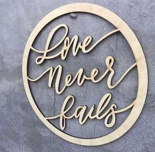 'Love never fails' wedding decoration