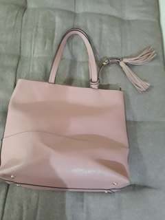 Authentic Charming Charlie pink bag
