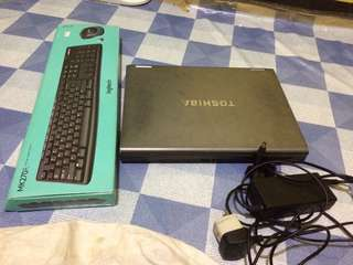 Toshiba laptop with wireless keyboard and mouse