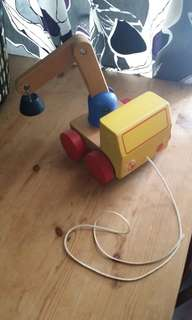 Wooden toy pull along