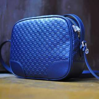 Gucci Micro Guccissima body bag in midnight blue, light pink