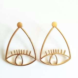 Po: Dangling Statement Eye Earrings
