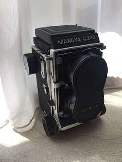 Mamiya c220 (TLR) with original lens cap