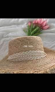 Brand new straw hat with cream lace ribbon tie