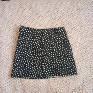 Black denim skirt with white floral pattern details