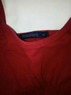 folded and hung red top