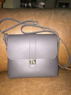 Miniso fringe grey sling bag