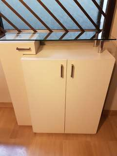White shoe cabinet with glass top