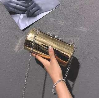 Gold cylinder bag sliver bag