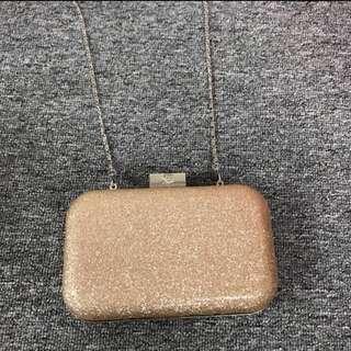 Lancome shiny small dinner sling bag
