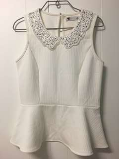 White peplum with sparkling jewels decoration on colllar