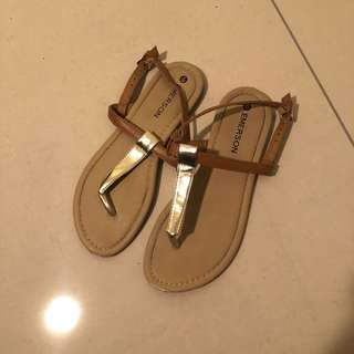 Gold and tan sandals