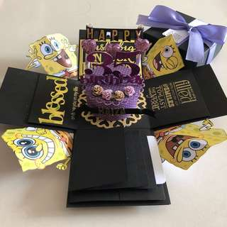 Spongebob explosion box with cake , waterfall in black, gold & purple