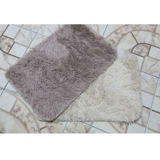 "White and Light Gray Fake Faux 12"" X 21"" Rugs"