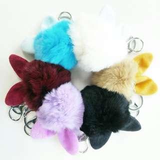 Furball with rabbit ears keychain